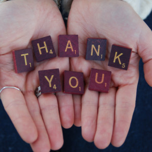 scrabble tiles says thank you in hands